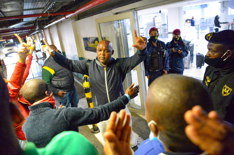 An emotional Pitso Mosimane, accompanied by his kids and wife, bids farewell to the Mamelodi Sundowns supporters who went to the OR Tambo to send him off as he flew out to Cairo.