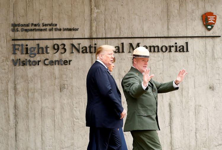 US President Donald Trump and first lady Melania Trump walk with park superintendent Stephen Clark at the Flight 93 National Memorial during the 17th annual September 11 observance at the memorial near Shanksville, Pennsylvania, US, September 11 2018. REUTERS/Kevin Lamarque