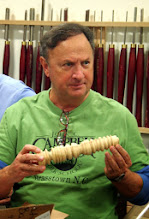 Photo: Stan Wellborn recently assisted Dick Sing in a turning class at the John C. Campbell Folk School.  The first project was turning beads... and more beads...  and more beads...
