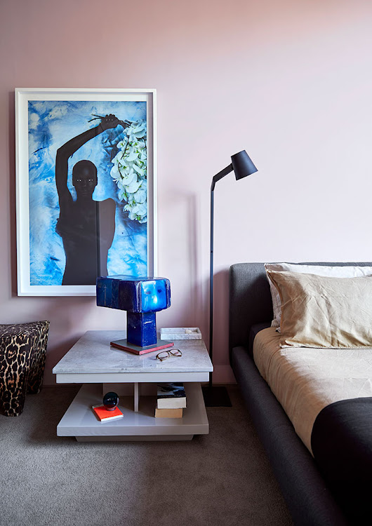 In the master bedroom, the artwork above the vintage side table is by Krisjan Rossouw.