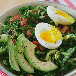 BLT Breakfast salad with soft boiled eggs and avocado.