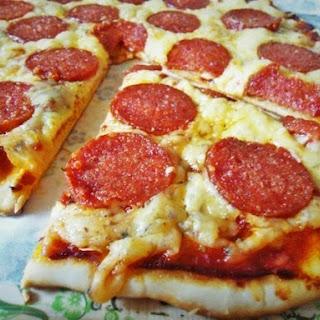 Pizza on thin crispy dough. Easier to nowhere!))).