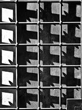 Photo: Grid Shadow of a cast iron window shutter in the old town in Rome... formed a nice geometric pattern.