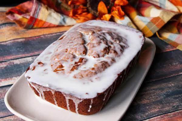 A Glazed Loaf Of Sweet Potato Banana Bread.