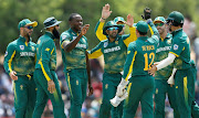Kagiso Rabada celebrates with his teammates after taking the wicket of Sri Lanka's Shehan Jayasuriya during the first one day international on July 29, 2018.