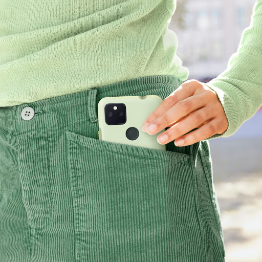 A person slipping their Pixel 5a phone with its Pixel 5a (5G) Case into their pocket.
