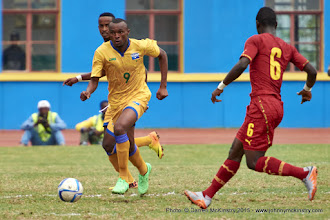 Photo: Jacques TUYISENGE (9) races forward as Affriyea Acqua (6) closes [Rwanda Vs Ghana AFCON2017 Qualifier, 5 Sep 2015 in Kigali, Rwanda.  Photo © Darren McKinstry 2015