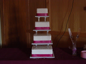 Photo: 4-Tier Squares w/Tall pillars and ribbon wrap