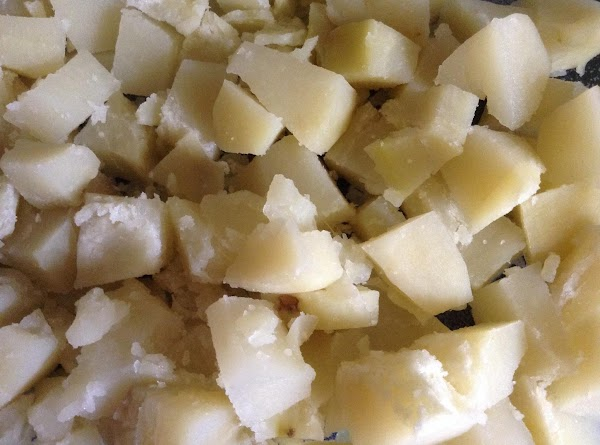 First, boil the peeled whole potatoes until 'almost' done. If I'm using red potatoes...