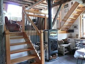 Photo: Appartement 1 - Le poêle à bois dans le coin repas