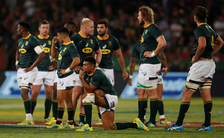 South Africa's Damian Willemse and teammates look dejected after the Rugby Championship match against New Zealand at Loftus Versfeld in Pretoria on October 6, 2018.