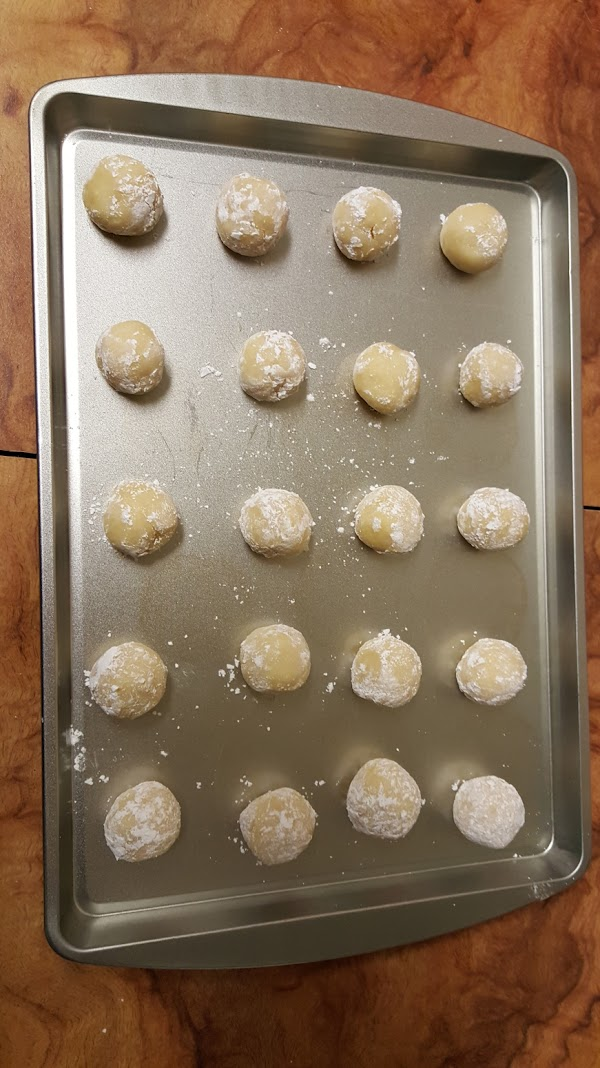 Put your powdered sugar on a plate or bowl.Using a teaspoon or small scooper,scoop...