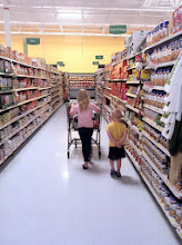 Photo: My kids had a few more minutes to choose what they wanted to dress up their scoops with. You can see they have these aisle's memorized. We were headed for the chili.