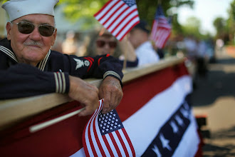 Photo: FAIRFIELD, CT - MAY 28: World War Two Navy veteran Edward Sabo rides on a float in the annual Memorial Day Parade on May 28, 2012 in Fairfield, Connecticut. Across America towns and cities will be celebrating veterans of the United States Armed Forces and the sacrifices they have made. Memorial Day is a federal holiday in America and has been celebrated since the end of the Civil War.  (Photo by Spencer Platt/Getty Images)