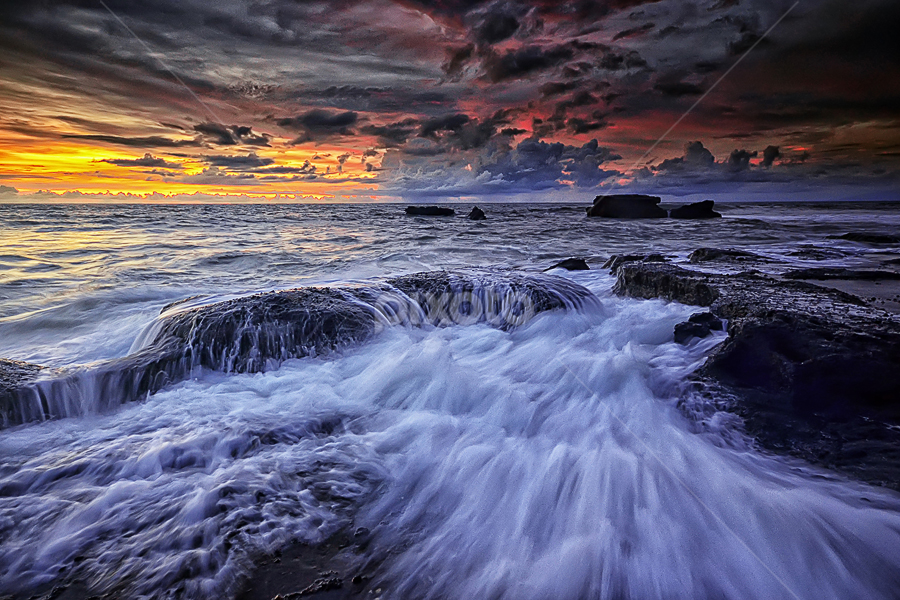 Heart of Stones by Hendri Suhandi - Landscapes Sunsets & Sunrises ( clouds, bali, waterscape, sunset, beach, sunrise, motion, stones, landscape, rocks )