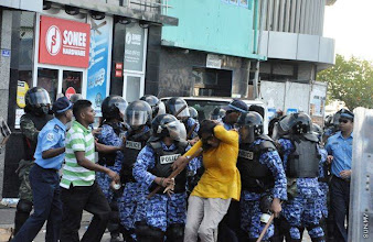 Photo: MP, Male', Former chairperson of MDP violently attacked by Police
