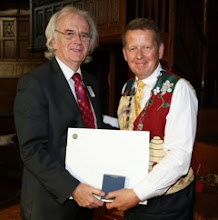 Photo: Speaker, Jim Loughrey, receiving a Peace Bridge print and paperweight from INIB President Bill Turnbull