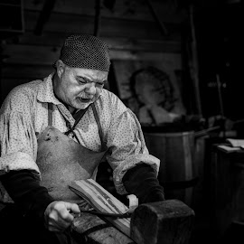 Shaving Lumber - B&W by Garry Dosa - Black & White Portraits & People ( historic, workshop, people, tools, march, professional, spring, national park, woodworking, person, indoors, action, rule of thirds, working, clothing, wood, man, barrel maker, male, environmental portrait )