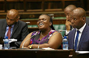 Former communications minister Faith Muthambi said it would have been 'just and honourable' for the authors of the report to 'hear my side of the story rather than to rubbish my name'.
