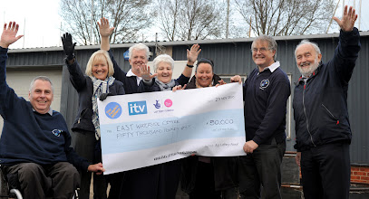 Photo: Celebrating the receipt of a cheque for £50,000 from the Peoples Millions.  This successful bid made possible our new Waterside Centre where we base our activities. (East Anglian Sailing Trust)