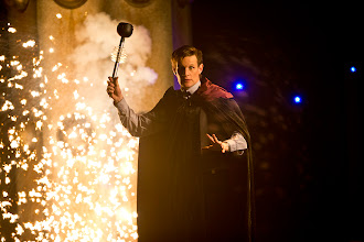 Photo: The Eleventh Doctor holding a Dalek eye-stalk and wearing a cape in the Doctor Who Christmas Special 2013, The Time of the Doctor.