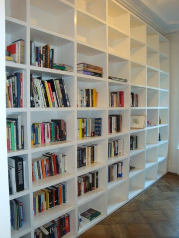 Photo: This wall to wall bookcase will never bow or break under the weight of its load thanks to veneer torsion box sandwich core panels.