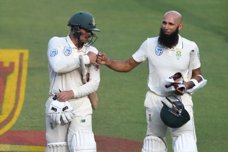 Quinton de Kock and Hashim Amla of the Proteas during day 2 of the 3rd Castle Lager Test match between South Africa and Pakistan at Bidvest Wanderers Stadium on January 12, 2018 in Johannesburg, South Africa.