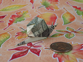Photo: Model: Dollar Snail;  Rear view;  Creator: Margaret Van Sicklen;  Folder: William Sattler;  1 dollar;  Publication: The Joy Of Origami (Margaret Van Sicklen) ISBN 0-7611-3988-5