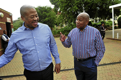 Bobby and Kaizer Motaung share a joke at the at Kaizer Chiefs Village yesterday, where they hosted a Fifa delegation that toured the club's academy and shared ideas about football development.