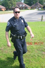 Photo: Tyler PD Offc Bernend with the RED TEXAS PENAL CODES BOOK IN HIS  LEFT HAND Like Casting PEARLS TO SWINE !!!   As we READ The Texas Penal Code 38.02 FAILURE TO ID I even Pointed to the WORD WHEN ARRESTED and EXPLAINED This Meant AFTER THE ARREST but He and Sgt Thompson Insisted That I could be arrested for FAILURE TO ID DURING THE DETENTION and Then The Next SECTION stated DETENTION  and They Exclaimed That They WERE NOT FUCK_UPS !! I Patiently Explained That This Meant If One Gave a FALSE NAME DURING THE DETENTION which Then Resulted in PERPLEXING LOOKS FROM ALL THIS INCOMPETENT PIECES OF SHIT THAT I WAS SURROUNDED BY and was WASTING My TAXPAYERS DOLLARS and WASTING MY TIME when They Could Be Fighting REAL CRIME // or Finding The Manufacturer of THOSE DENTAL AMALGAMS  !!!