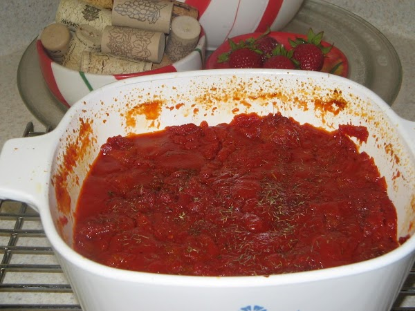 Now carefully pour the hot  tomato mixture evenly over the bread.Sprinkle with the...