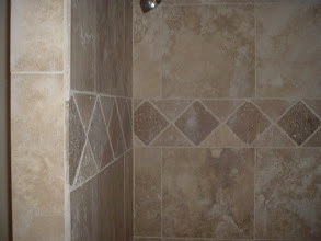 Photo: shower wall with diamond design in middle.