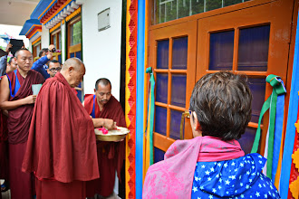 Photo: During the Grand Opening ceremony, His Holiness Menri Trizen Rinpoche led others in a ritual to purify and bless the Sowa Rigpa Medical Institute with blessed rice and fresh flower petals.