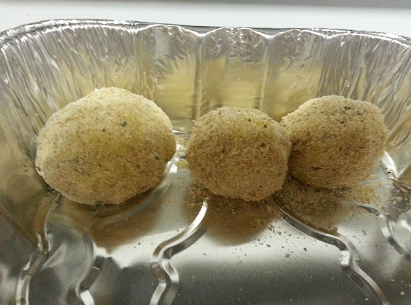 Dip the rice balls in the beaten eggs and then roll in the bread...