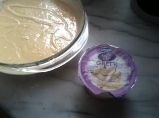 Mix cake ingredients minus cup of water, add banana yogurt and bake till toothpick...
