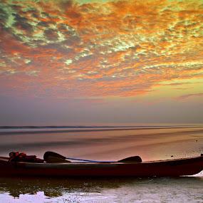 Lonely boat by Soumen  Basu Mallick - Landscapes Weather ( clouds, nature, colors, sunset, background, sea, boat, landscape )