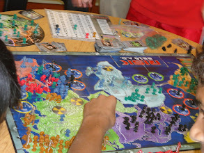 Photo: Peope playing Risk