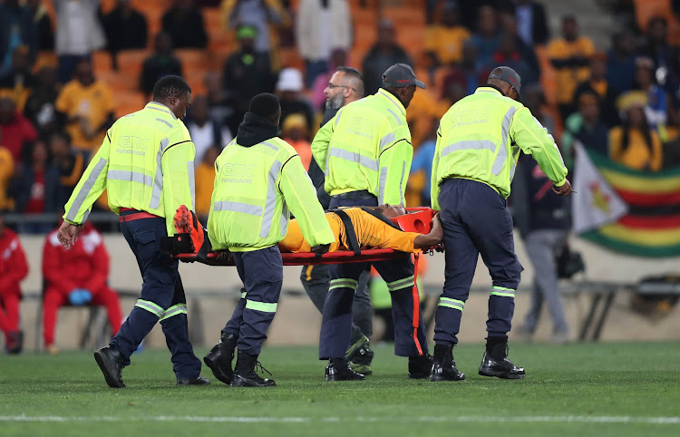 Kaizer Chiefs attacking midfielder Joseph Molangoane is stretchered off after sustaining horrific injury during the MTN8 quarterfinal match Free State Stars at FNB Stadium on August 11 2018.