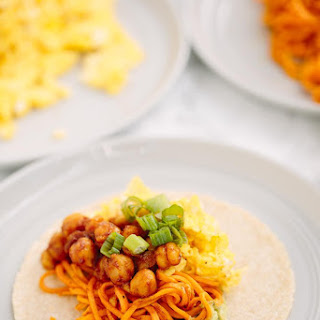 BBQ Chickpea Sweet Potato Noodle Breakfast Tacos with Eggs, Avocado Sauce and Scallions.