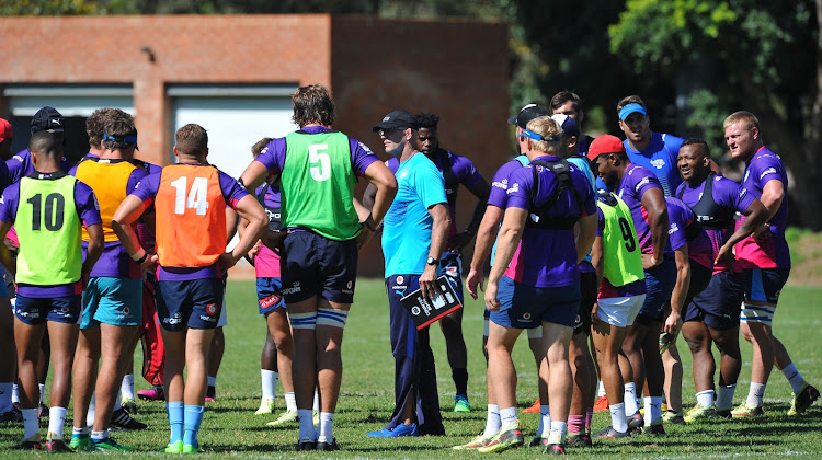 The Vodacom Bulls head coach John Mitchell has a chat with his players during a training session at Loftus Versfeld.