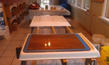 Photo: first coat of primer on the turtle and campanionway cover.