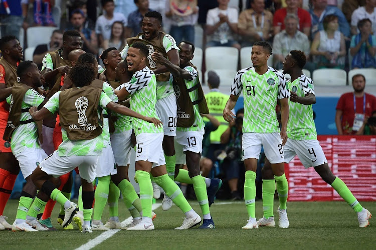 Nigeria's players celebrate after scoring their opener during the Russia 2018 World Cup Group D football match between Nigeria and Iceland at the Volgograd Arena in Volgograd on June 22, 2018.