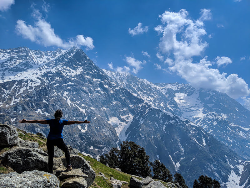 solo indian traveler admiring the himalayas being used as a feature image for visas for indian citizens guide