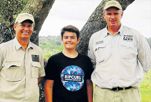 SAVING RHINOS: Riley Devan, 13, a Grade 8 pupil at Selborne College, has raised more than R25 000 for organisations involved with saving rhinos. Riley is flanked by Chipembere Rhino Foundation's Brent Cook, left, and Dr Williams Fowlds Picture: SUPPLIED