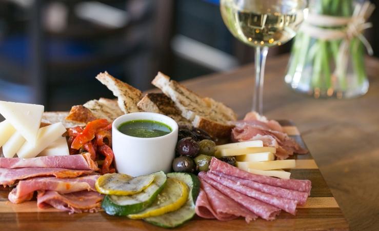 Charcuterie board and wine at Rusconi's America Kitchen in Phoenix