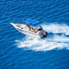 Boat on tropical blue water by Martin Wheeler - Transportation Boats ( boat ocean water waves wave white blue fast )