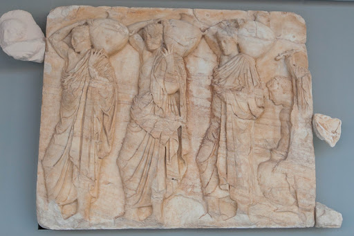 Recovered-ancient-artwork-2.jpg - A relief depicting people carrying amphoras (water containers) at the Acropolis Museum in Athens.