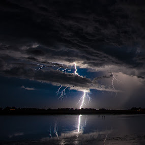 Reflections of Lightning & clouds over the water by Jordon Ward - Landscapes Starscapes ( clouds, reflection, lightning, bolt, weather, reflections, electricity, night, storm, mother nature )