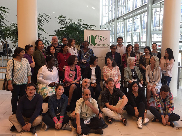 photo of a group of approximately 30 people at a conference