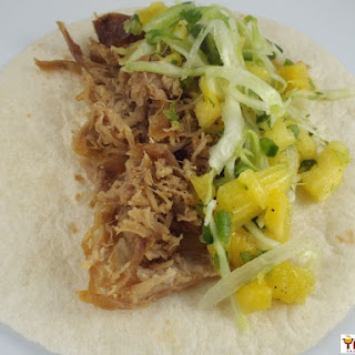 Slow Cooker Kalua Pork Tacos with Spicy Pineapple Slaw.